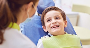 little boy smiling at his children's dentist in Weatherford
