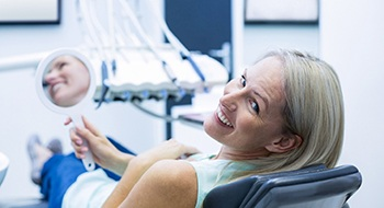 Woman in dental chair after root canal therapy.