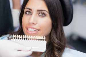 A woman choosing porcelain veneers.