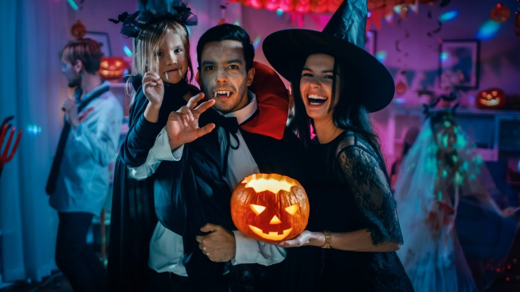 Closeup of family smiling during Halloween party