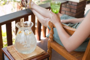 Woman on porch with jug of tap water thanks to recommendation from the dentist weaterford residents prefer