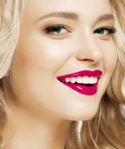 Woman with gorgeous smile following teeth whitening